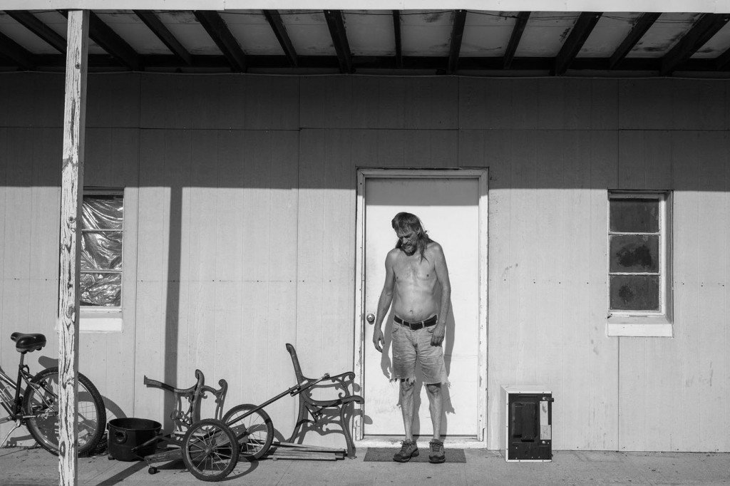 Vernon outside of his apartment. Because he is on disability as a result of the stroke and two heart attacks he's suffered, he receives Medicaid from the state which is the only way for him to receive any type of health insurance. His doctor was previously based in Independence but moved to Bartlesville, Oklahoma which is one hour south. Independence, KS. July 18, 2017.