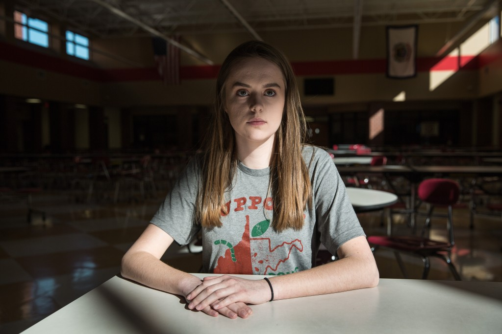 "High School student Hannah Criser sits in her empty cafeteria last Monday in Morgantown, West Virginia. Criser's father is a second trade teacher--one of tens of thousands who struck for nine days. ""Because he's the primary breadwinner in our family, I qualify for free or reduced lunches based off his salary,"" Criser said. ""I shouldn't have to qualify for that from my father's salary as a public educator in this state. They obviously need the pay increase."""