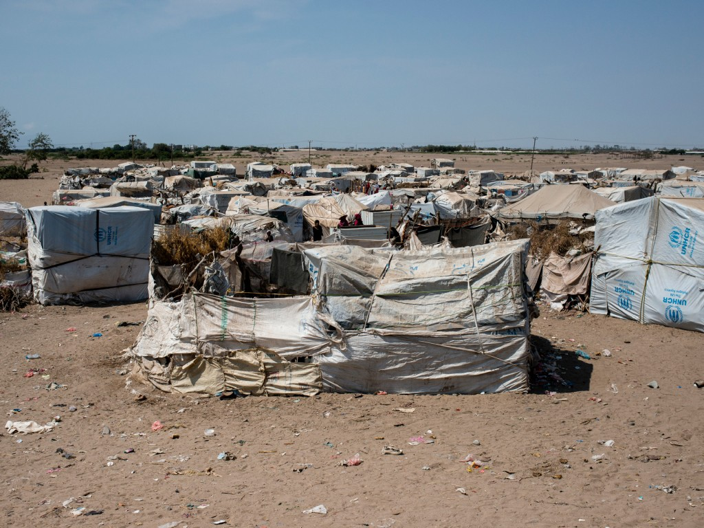 The makeshift tents held together with rope and protected by sticks and brush bake under the sun, on April 23, 2018 in Mishqafa Camp, Al Fayoush, Yemen. There is no running water, bathrooms, or official health facility.