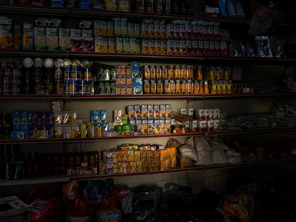 Light shines on goods in a convenience store on April 30 in Sana'a, Yemen.
