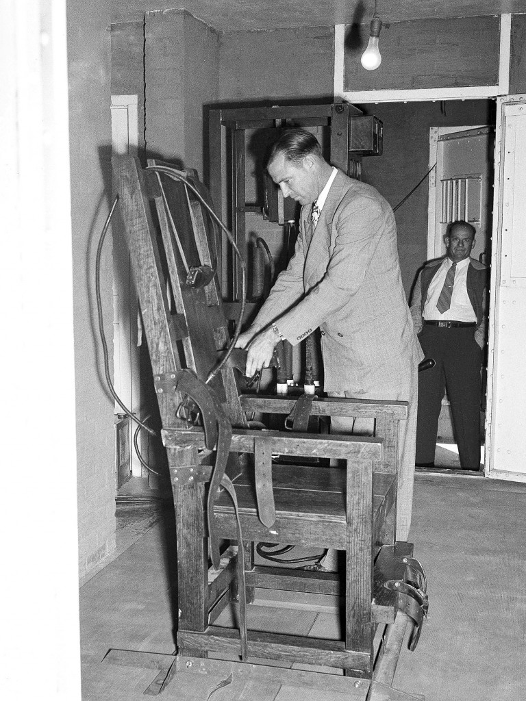 An unidentified attendant checks Louisiana's portable electric chair in the parish jail at St. Martinville, Louisiana on May 9, 1947, before Willie Francis, 18-year-old African American, was electrocuted for a robbery slaying. A year ago they tried to electrocute Willie, but the chair wouldn't work. On his second trip to the chair, he was pronounced dead five minutes after the switch was thrown. (AP Photo/Bill Allen)