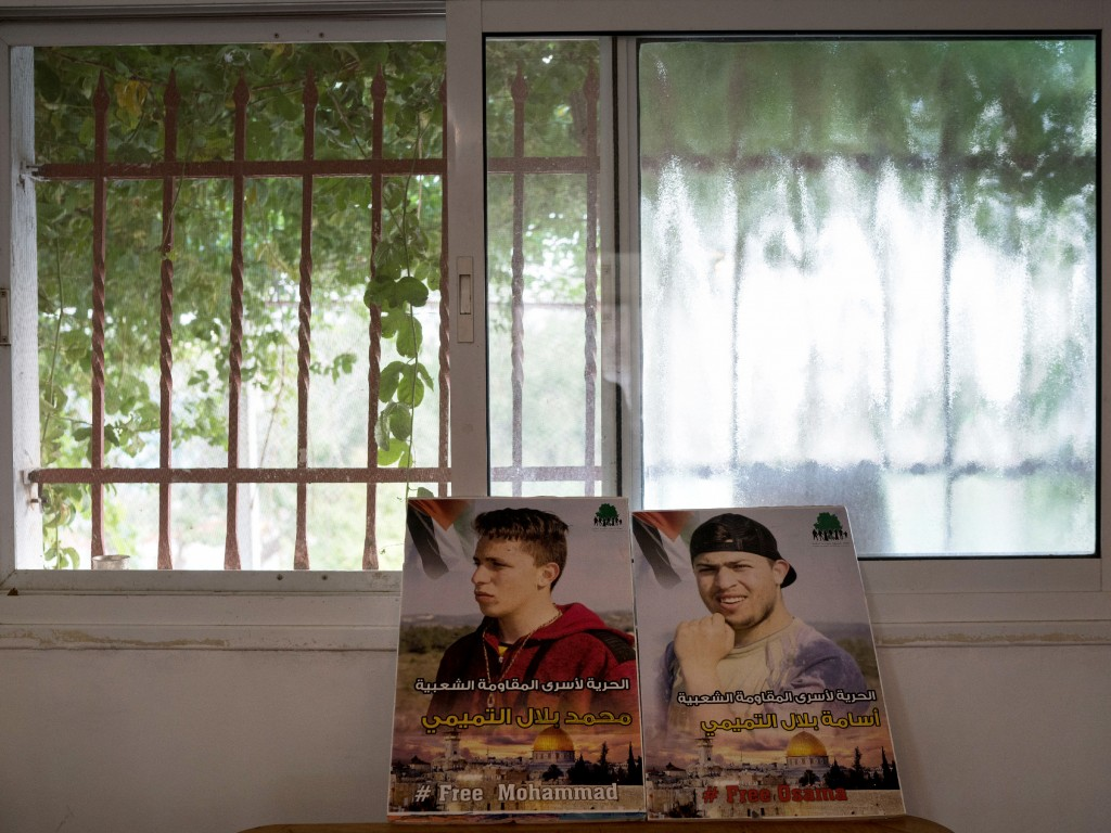 Posters of Nariman's imprisoned sons are seen inside their house in Nabi Saleh on July 29, 2018