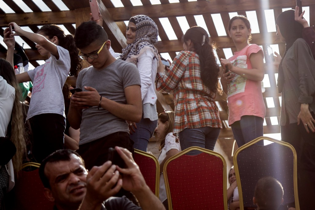 Relatives and jouranslists wait at Ahed Tamimi's house in Nabi Saleh following her release  on July 29, 2018.