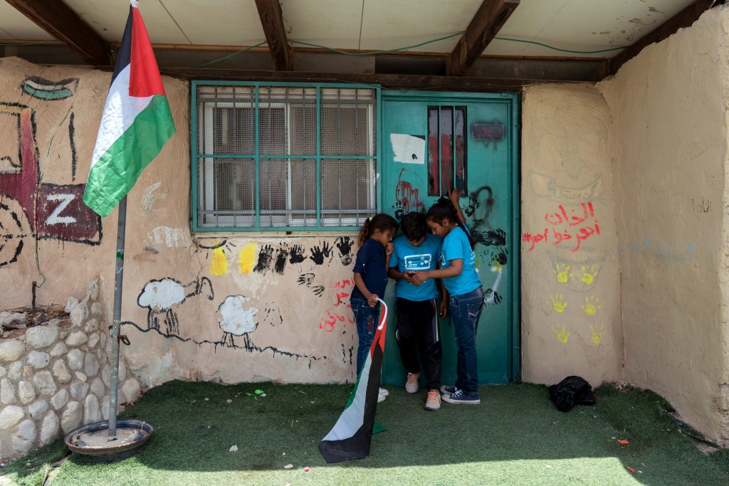 Palestinian Bedouin children are seen at the school in the Al-Khan Al-Ahmar village on July 26, 2018.