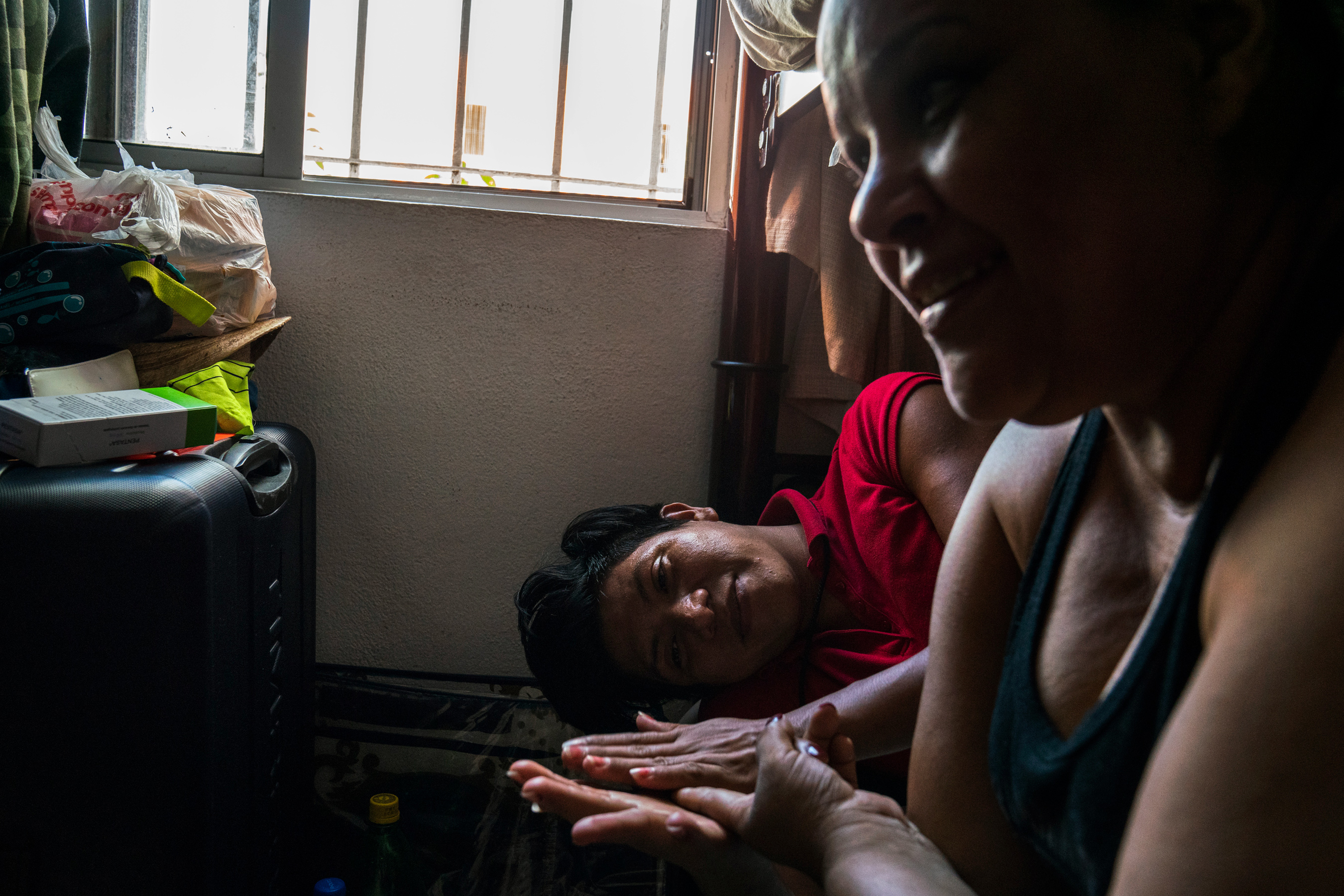 Sandy, 22, left, a trans woman from Guatemala and her friend Tania, 42, from Honduras rest at a shelter in Matamoros, Tamaulipas on Nov. 7, 2018. Sandy has been waiting for four months to seek asylum because Customs and Border Protection, CBP, agents have told her that they are at full capacity.Photo: Verónica G. Cárdenas for The Intercept