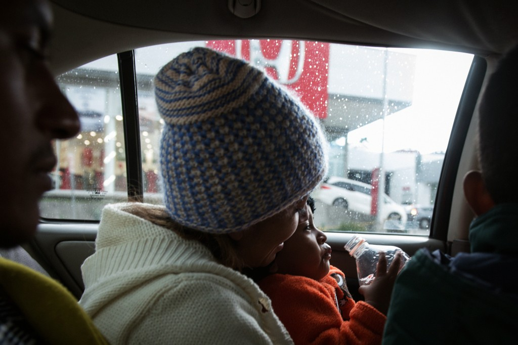 Eric, Oneida, Kelvin and Julian share the back seat of a taxi to the hospital on December 6, 2018.