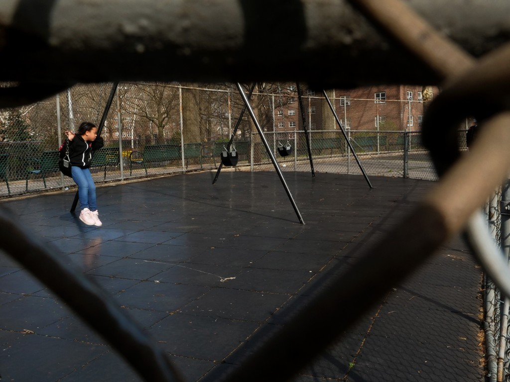 A girl plays in the playground in Eastchester Gardens Housing Project.