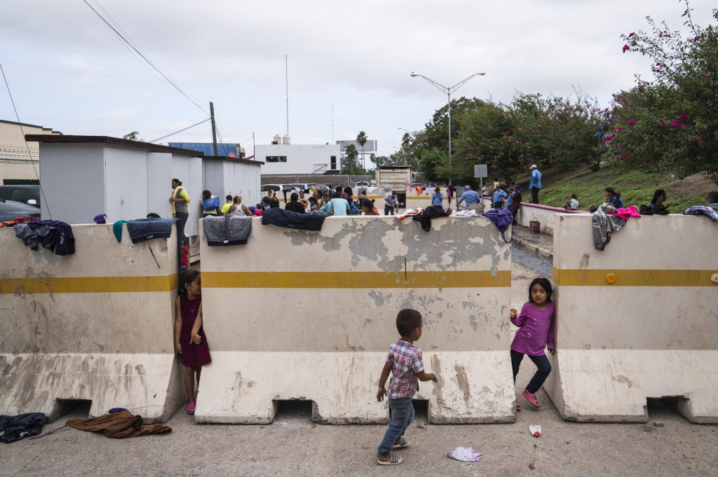 Asylum-seeking children play in an encampment where they live near the Gateway International Bridge on Oct. 22, 2019 in Matamoros, Mexico. Verónica G. Cárdenas for The Intercept