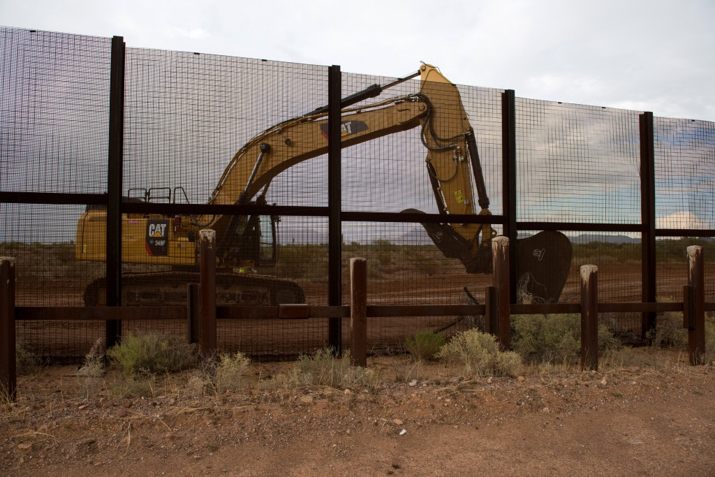 Lukeville, Ariz. September 26, 2019: A tractor destroys the extant barrier in preparation for the installation of a new taller barrier to the east of Lukeville, Ariz. on Thursday September 26, 2019. (Ash Ponders for The Intercept)
