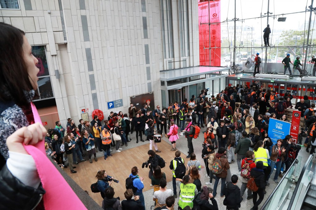 "Protestors block the doors during a demonstration on October 5, 2019 in the Italie Deux shopping mall in Paris, called by Extinction Rebellion environmental activist movement. - Extinction Rebellion announced disruption to 60 cities around the world from October 7 in a fortnight of civil disobedience, warning of an environmental ""apocalypse"". (Photo by JACQUES DEMARTHON / AFP) (Photo by JACQUES DEMARTHON/AFP via Getty Images)"