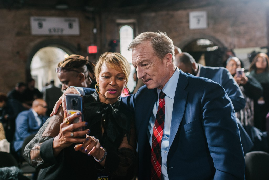 Donna Hylton, center, takes a photo with Democratic presidential candidate Tom Steyer during a presidential town hall moderated by formerly incarcerated people at the Eastern State Penitentiary in Philadelphia, PA. on Monday, October 28, 2019. Steyer was one of three presidential candidates that showed up to the town hall.Hannah Yoon for The Intercept