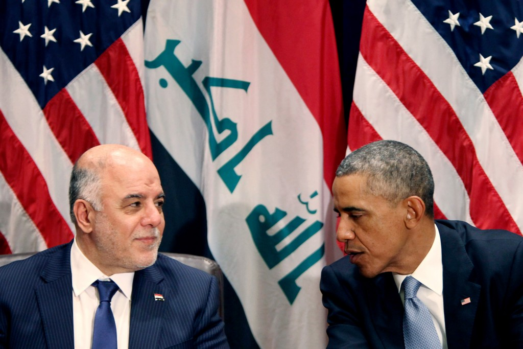 NEW YORK, NY - SEPTEMBER 24:  (AFP OUT) U.S. President Barack Obama (R) holds a bilateral meeting with Prime Minister of Iraq Haider al-Abadi during the 69th United Nations General Assembly at United Nations Headquarters on September 24, 2014 in New York City. The annual event brings political leaders from around the globe together to report on issues meet and look for solutions. This year's General Assembly has highlighted the problem of global warming and how countries need to strive to reduce greenhouse gas emissions. (Photo by Allan Tannenbaum-Pool/Getty Images)