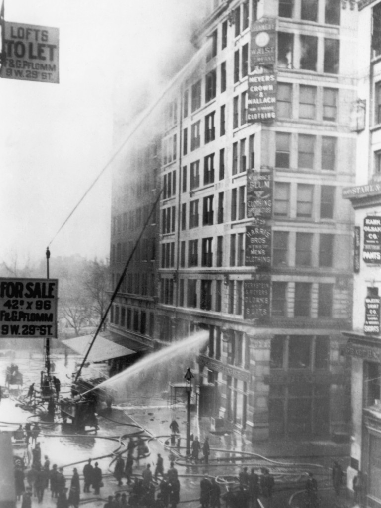 Fire fighters try to put out the 1911 catastrophic fire at the Triangle Shirtwaist Factory Building which killed 146 workers as a result of looked doors and missing fire escapes. (Photo by George Rinhart/Corbis via Getty Images)