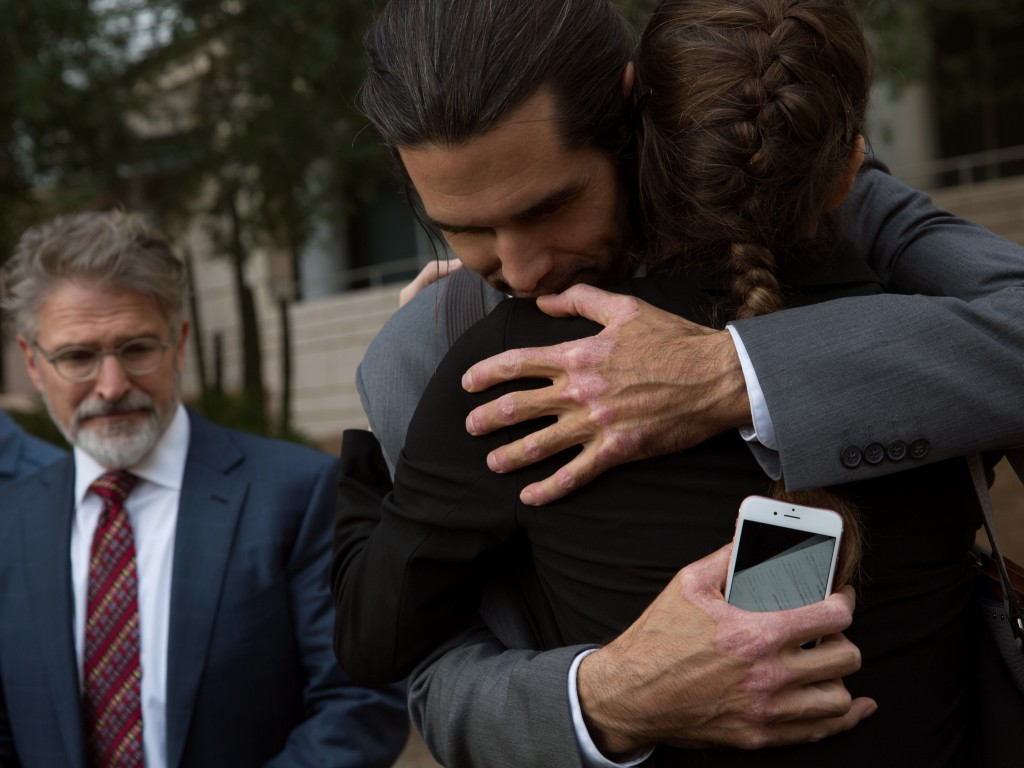 Scott Warren embraces his attorney, Amy Knight after a jury returned two not-guilty verdicts.