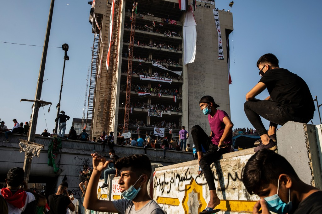 Thousands of people flood Tahrir Square in Baghdad for an antigovernment protest, on Nov. 1, 2019. As protests gripped the country's south and the capital, a rocket attack in the north created a new level of uncertainty. (Ivor Prickett/The New York Times)