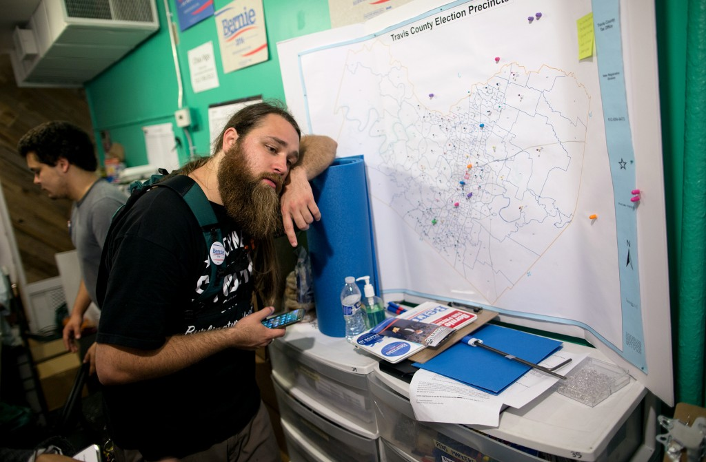 Matt Krausse, a Bernie Sanders campaign volunteer, strategizes where to distribute brochures reminding Sanders supporters to vote in the Super Tuesday primaries, at the campaign headquarters in Austin, Texas early Tuesday morning, March 1, 2016. The local Sanders campaign mobilized over 40 volunteers in a grassroots effort to canvas Austin neighborhoods before dawn. (AP Photo/Tamir Kalifa)