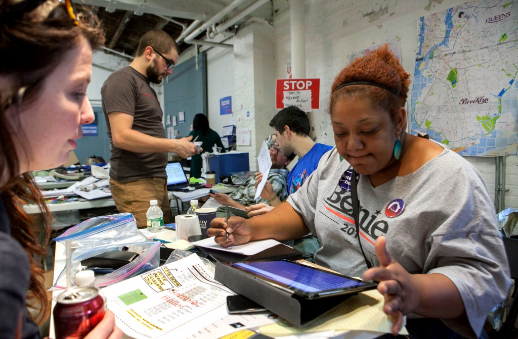 Staffer Melanie (right) helps volunteers at the NY State Bernie Sanders headquarters in the neighborhood of Gowanus in Brooklyn, NY on the 19th of April, 2016. This is the date of NY State primaries for both the Democratic and the Republican parties in order to select their candidates for the US presidential election of the upcoming November. Photo by: Alessandro Vecchi/picture-alliance/dpa/AP Images