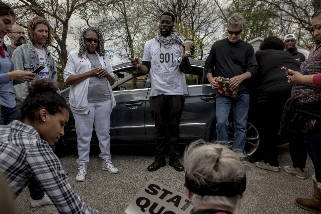 April 3, 2018 - Memphis, TN: Keedran Franklin (center) helps to organize a series of protests with other community members in April 2018. They wanted to leverage the national attention that Memphis had on it on the eve of the 50th commemoration of Dr. Martin Luther King Jr.'s assassination. They were protesting a range of social issues, from the problems with the labor models at FedEx, the city's largest employer, to cooperation between local law enforcement and ICE.  Photo by Andrea Morales.