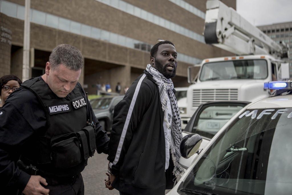 April 3, 2018 - Memphis, TN: Keedran Franklin is arrested by the Memphis police department in front of the city's justice center while he was helping protestors cross the street during an action. Franklin helped to organize a series of protests with other community members in April 2018. They wanted to leverage the national attention that Memphis had on it on the eve of the 50th commemoration of Dr. Martin Luther King Jr.'s assassination. They were protesting a range of social issues, from the problems with the labor models at FedEx, the city's largest employer, to cooperation between local law enforcement and ICE.  Photo by Andrea Morales.