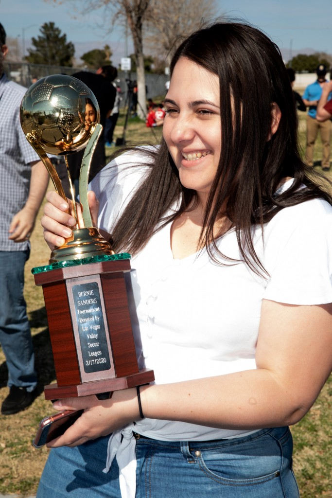 Laura Becerra, the Latinx constituency organizer for the Sanders campaign holds the winning trophy at the Eldorado Highschool soccer fields in Las Vegas, Nevada for the Unidos Con Soccer Tournament on Feb 17, 2020. Krystal Ramirez for The Intercept