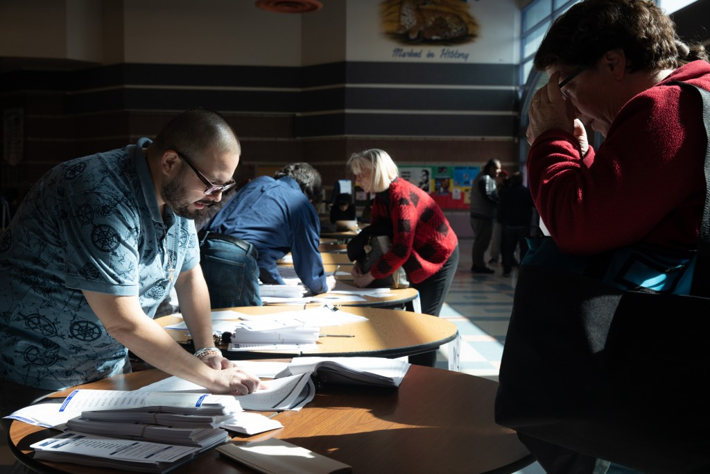 Voters gather for the Nevada Democratic Party caucuses at Desert Pines Highschool in Las Vegas, Nevada on February 22nd, 2020. Krystal Ramirez for The Intercept