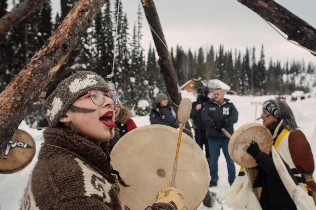 Denesuline supporter Victoria Redsun stands in ceremony with Ts'akë ze' Howihkat, Freda Huson, as police arrive to enforce Coastal GasLink's injunction at Unist'ot'en Healing Centre near Houston, B.C. on Monday, February 10, 2020. Redsun, Huson and five others were arrested that day. Amber Bracken