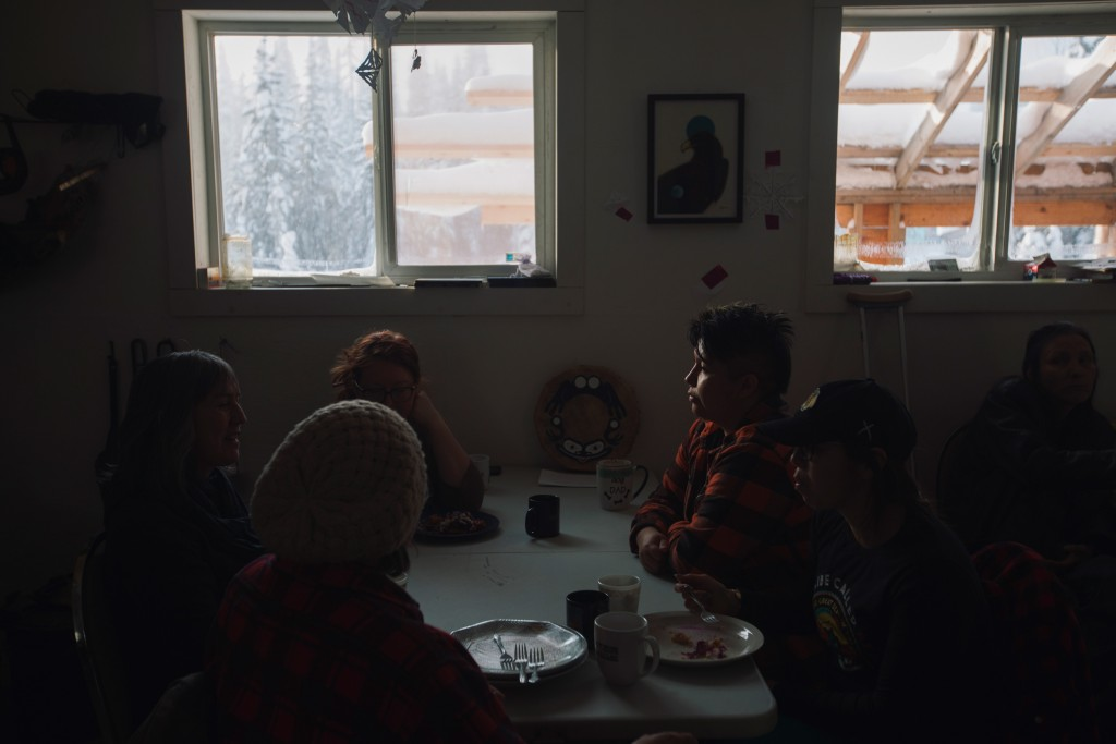 Wet'suwe'ten family and other supporters gathers with Freda Huson, left, in the dining hall at the Healing Centre at Unist'ot'en camp near Houston, B.C. on Wednesday, January 15, 2020. Amber Bracken