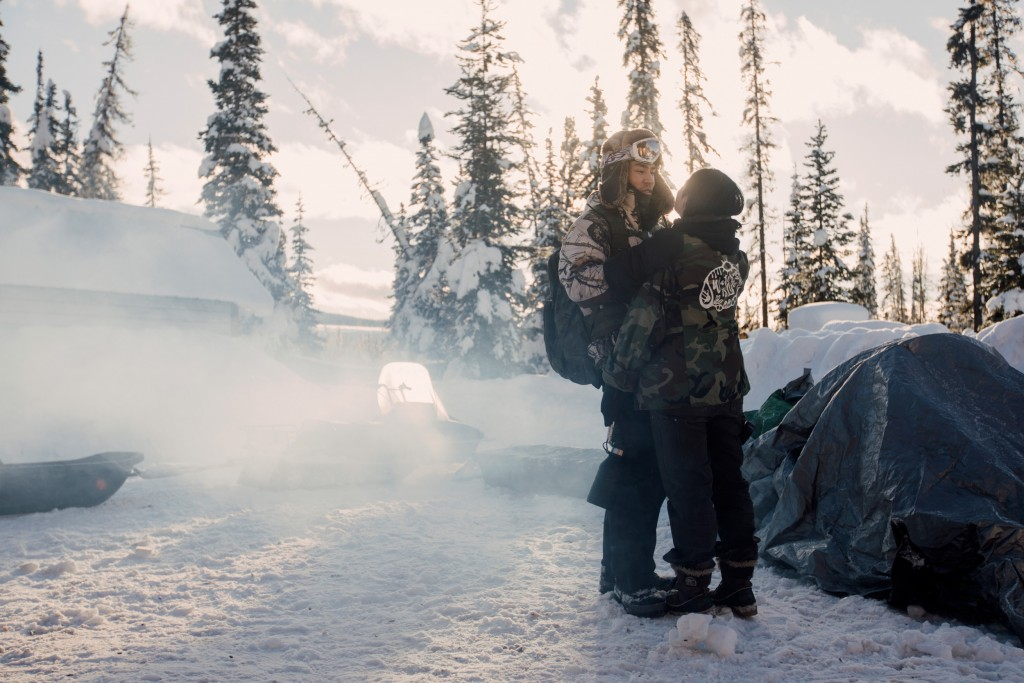 Denzel Sutherland-Wilson and Victoria Redsun share a moment before Sutherland-Wilson had to head out into the territory, to hunt and retrieve a canvas tent, near Houston, B.C. on Saturday, January 25, 2020. Sutherland-Wilson is a member of the Gitxsan nation, a longtime ally to the Wet'suwet'en and co-plaintiff on the landmark 1997 Delgamuukw vs. The Queen court decision. Amber Bracken