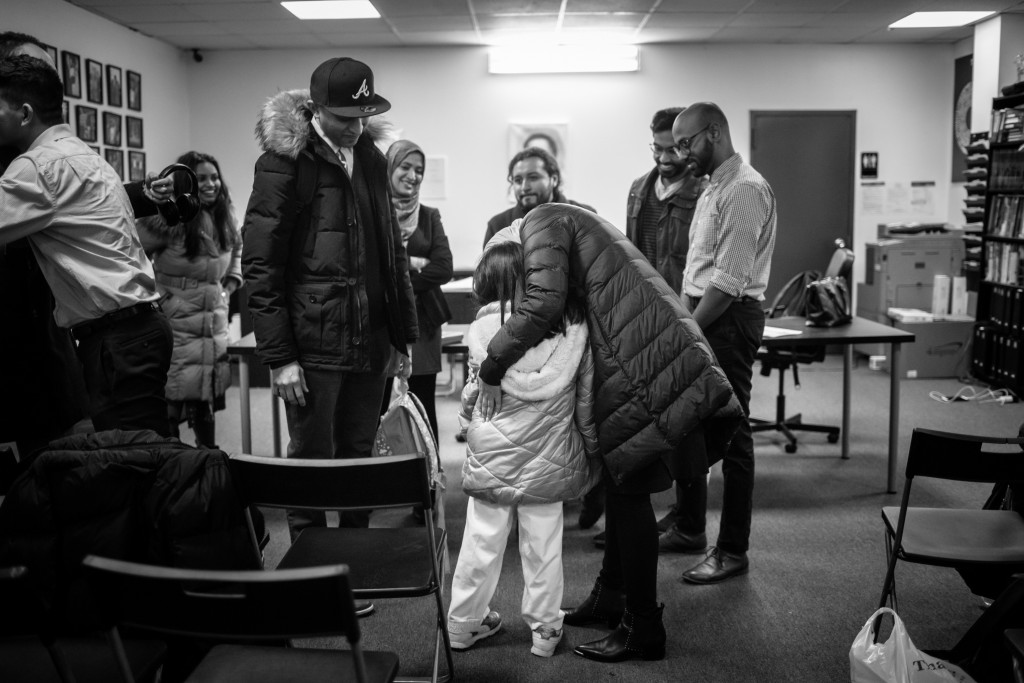 Linda Sarsour hugs Arianna Khan, 7, at a Muslim Democratic Club of New York meeting in Queens Tues. Feb. 11, 2020. Kholood Eid for The Intercept