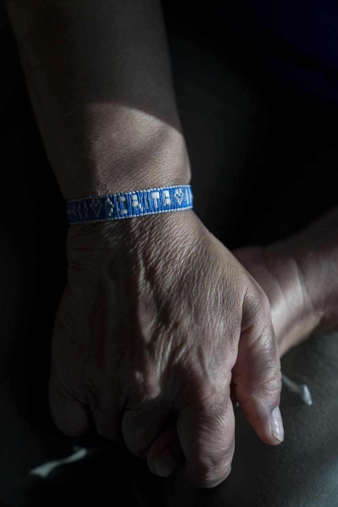 TUCSON, AZ - MARCH 13, 2020:Detail of a bracelet that says 'DORITA' that an asylum seeker in an ICE detention facility made out of plastic bags for Dora Rodriguez. In 1980 19-year-old Dora Rodriguez, from El Salvador, made the difficult journey of crossing into the US near Lukeville, AZ on foot. Of the 26 individuals she crossed the Sonoran desert with 13 died in the gruelling heat, one of the pre-eminent events that led to the Sanctuary Movement. Dora eventually naturalised in the US and started an advocacy group, Salvavision Rescue Arizona, to support asylum-seekers. On a weekly basis Dora visits asylum seekers in detention centres, writes them letters, fundraises and brings donated supplies to the migrant camps on the Mexican side of the US - Mexico border. Photo by Kitra Cahana/MAPS for The Intercept