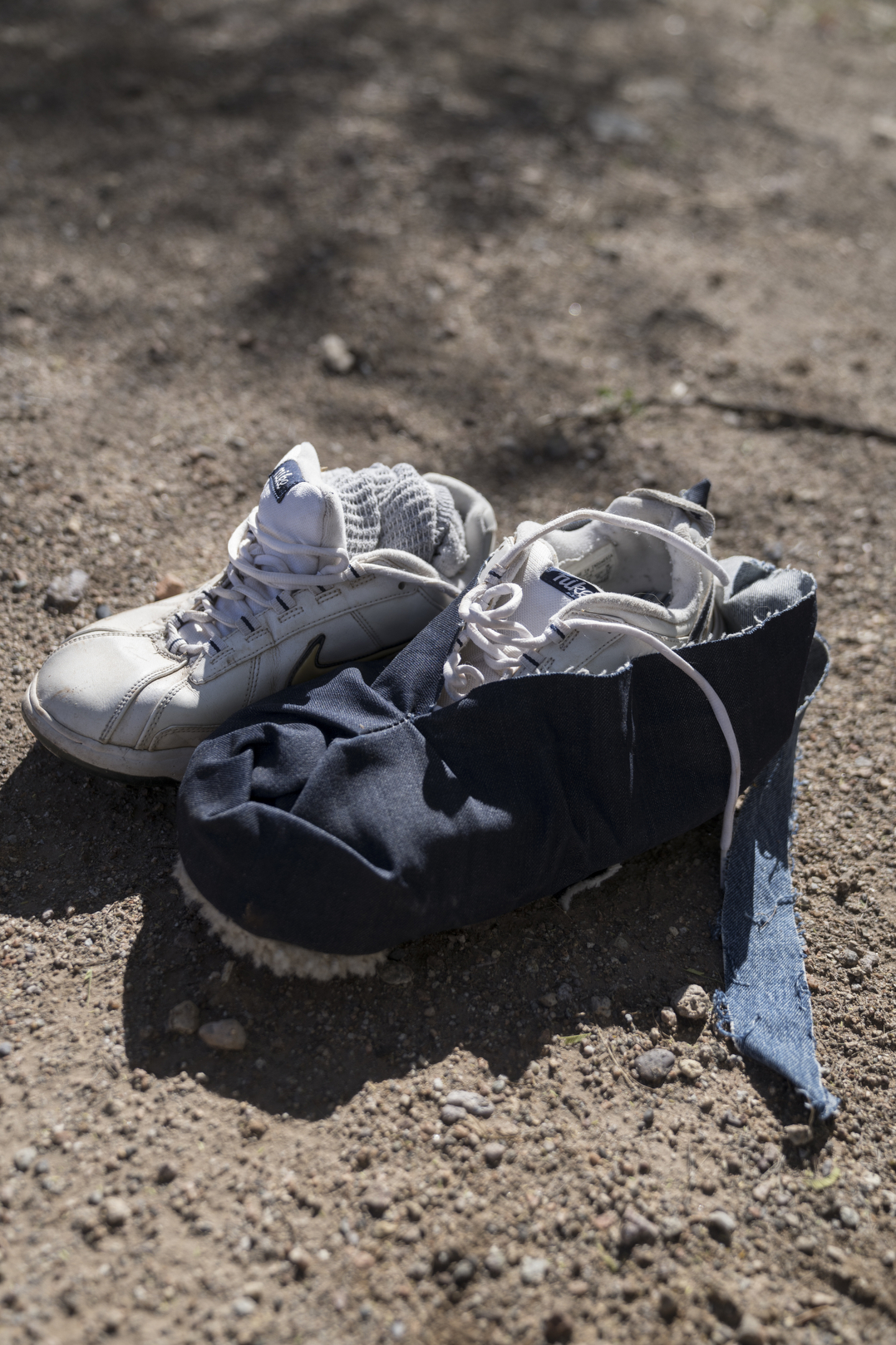 TUCSON, AZ - MARCH 13, 2020:Detail of items that Dora Rodriguez collected in July 2019 from the site where she was rescued in 1980 as a young asylum seeker crossing the Sonoran desert. Dora went back to the location with artist Alvaro Enciso in order to lay a cross at the site.In 1980 19-year-old Dora Rodriguez, from El Salvador, made the difficult journey of crossing into the US near Lukeville, AZ on foot. Of the 26 individuals she crossed the Sonoran desert with 13 died in the gruelling heat, one of the pre-eminent events that led to the Sanctuary Movement. Dora eventually naturalised in the US and started an advocacy group, Salvavision Rescue Arizona, to support asylum-seekers. On a weekly basis Dora visits asylum seekers in detention centres, writes them letters, fundraises and brings donated supplies to the migrant camps on the Mexican side of the US - Mexico border. Photo by Kitra Cahana/MAPS for The Intercept