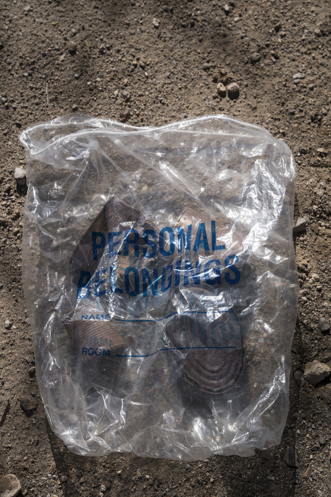 TUCSON, AZ - MARCH 13, 2020: Detail of items that Dora Rodriguez collected in July 2019 from the site where she was rescued in 1980 as a young asylum seeker crossing the Sonoran desert. Dora went back to the location with artist Alvaro Enciso in order to lay a cross at the site. In 1980 19-year-old Dora Rodriguez, from El Salvador, made the difficult journey of crossing into the US near Lukeville, AZ on foot. Of the 26 individuals she crossed the Sonoran desert with 13 died in the gruelling heat, one of the pre-eminent events that led to the Sanctuary Movement. Dora eventually naturalised in the US and started an advocacy group, Salvavision Rescue Arizona, to support asylum-seekers. On a weekly basis Dora visits asylum seekers in detention centres, writes them letters, fundraises and brings donated supplies to the migrant camps on the Mexican side of the US - Mexico border.  Photo by Kitra Cahana/MAPS for The Intercept