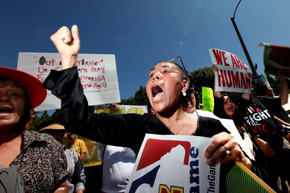 Demonstrators Protest Against AZ Sheriff Arpaio During His Visit To CA