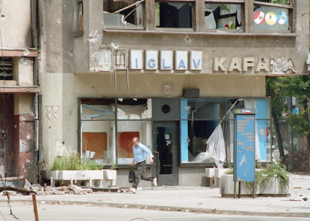 Man Running in Bombed-Out Sarajevo