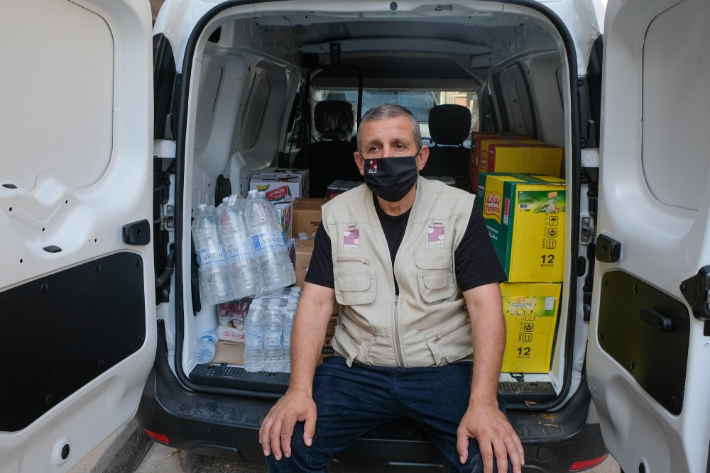 Hussein is the driver. He helps everyday for the transportation to more than thousand families in need.