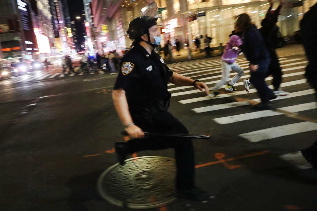 NEW YORK, NEW YORK - MAY 31: Police confront protesters in Manhattan on May 31, 2020 in New York City. Minneapolis Police officer Derek Chauvin was filmed kneeling on George Floyd's neck who was later pronounced dead at a local hospital. Floyd's death, the most recent in a series of deaths of African Americans while in police custody, has set off days and nights of protests across the country. (Photo by Spencer Platt/Getty Images)